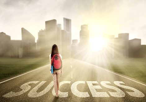 Image of success - young woman heading toward the city