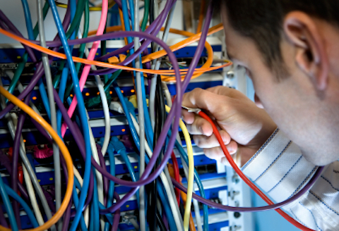 IT technician working at network server computers