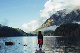 girl and mountain lake